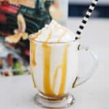 butter beer in a glass mug with a striped straw