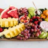 fresh fruit platter on wood board