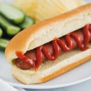hot dog on white plate