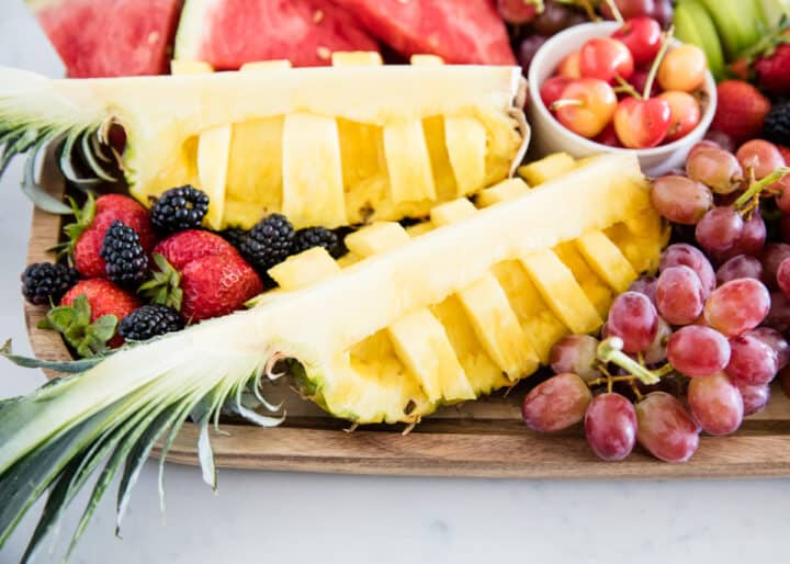 cut pineapple on fruit board