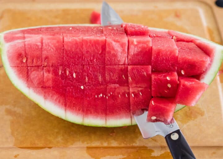 cutting watermelon into cubes