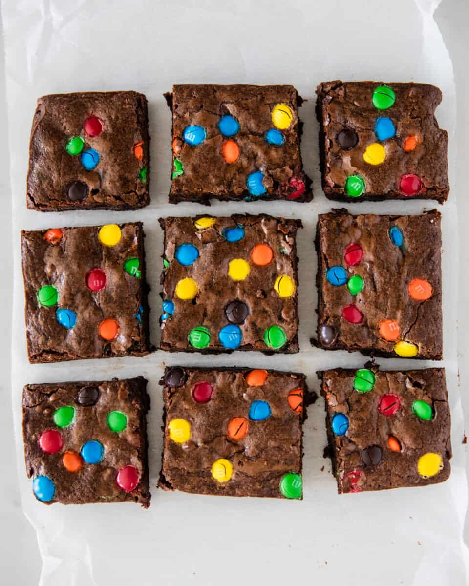 sliced m&m brownies on parchment paper