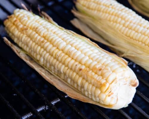 grilling corn in husk