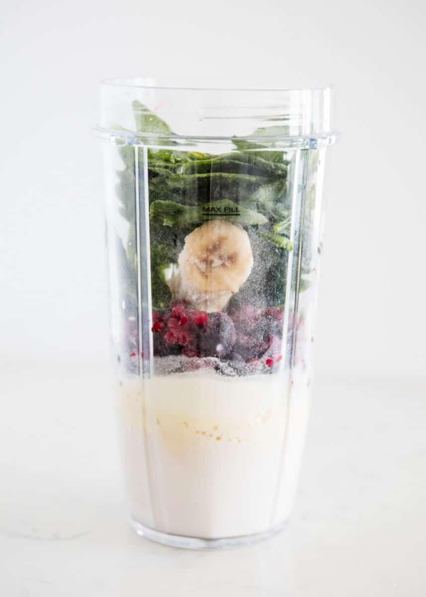 blender full of protein smoothie ingredients