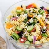 greek pasta salad in a glass bowl
