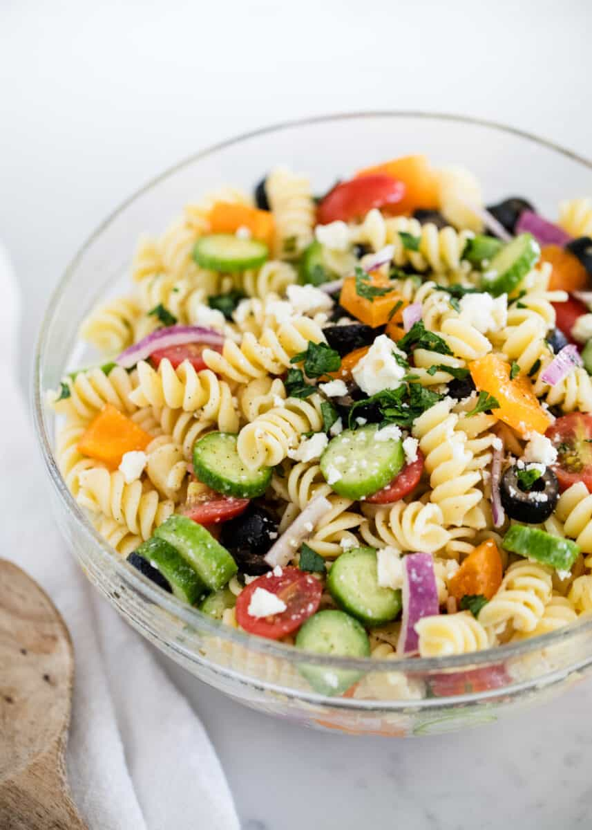 greek pasta salad in a glass bowl