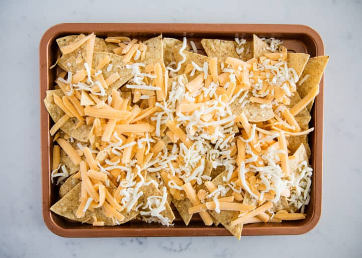 tortilla chips with cheese on pan