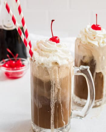 root beer float with red straw and cherry on top
