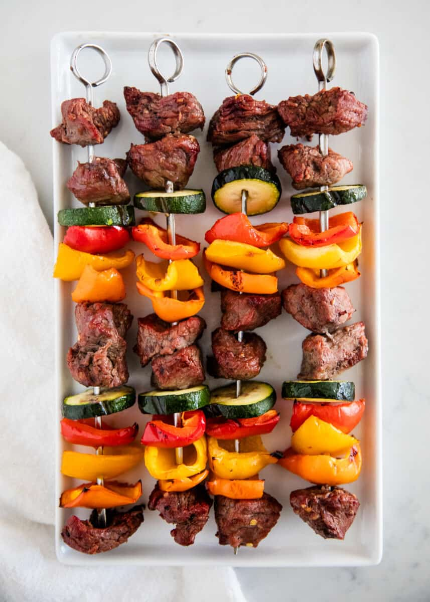 steak kabobs on white plate