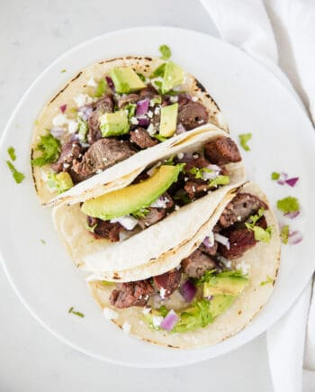 steak tacos on white plate