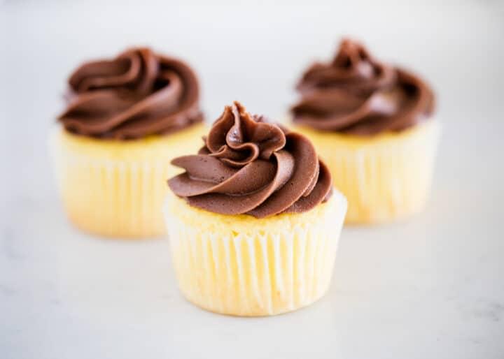 vanilla cupcakes on counter