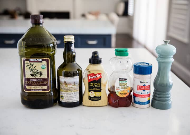 balsamic dressing ingredients lined up on counter
