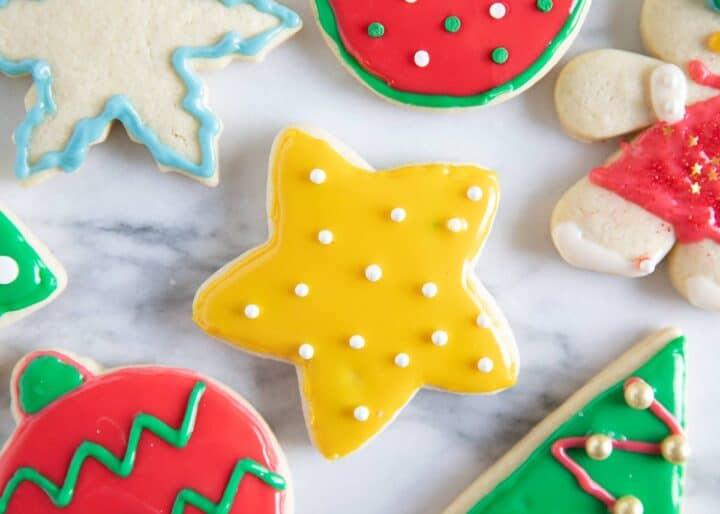 Iced christmas sugar cookies on counter