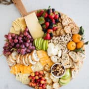 fruit and cheese platter on circle board