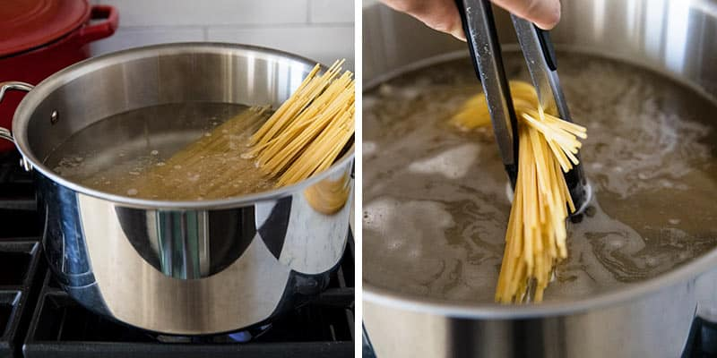 cooking pasta in a pot of water