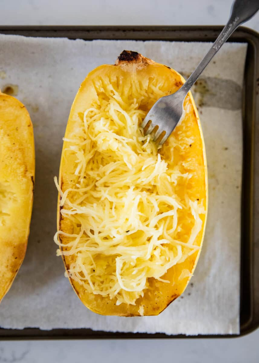 cooked spaghetti squash on baking sheet