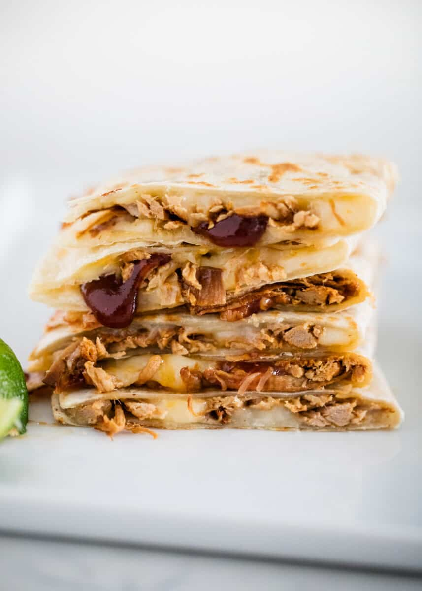 bbq pulled pork quesadilla slices stacked on plate
