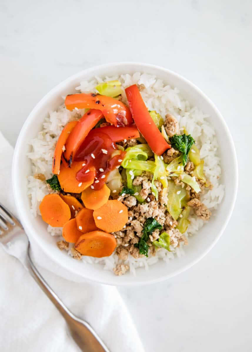 ground turkey with vegetables and rice in bowl