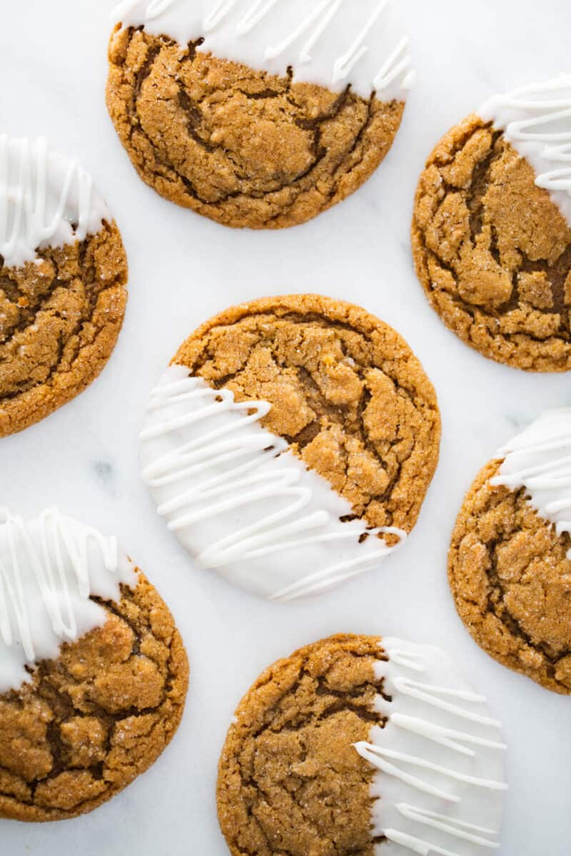 molasses cookies with half dipped in white chocolate
