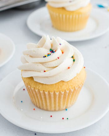 vanilla cupcake on white plate