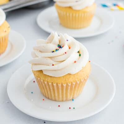 vanilla cupcake on white plate