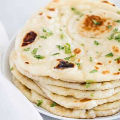 stacked naan bread on plate