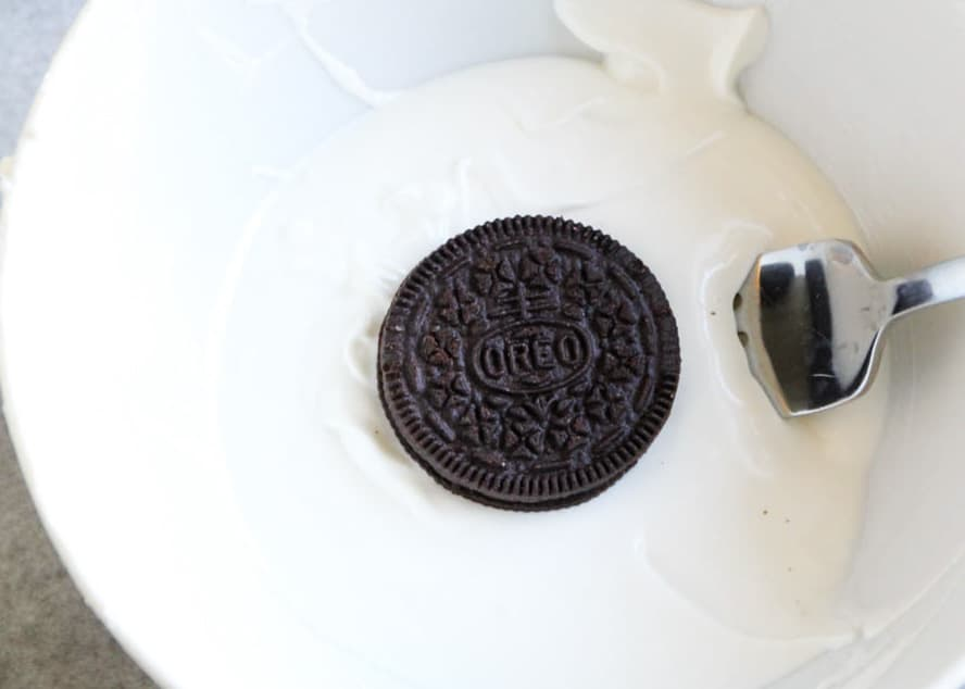 dipping Oreo in white chocolate