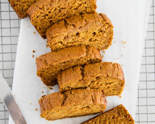 sliced pumpkin banana bread on cooling rack