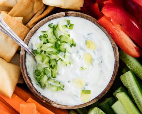 tzatziki sauce in wooden bowl
