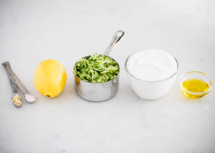 tzatziki sauce ingredients on counter