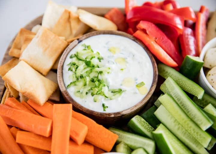 tzatziki sauce on platter with vegetables