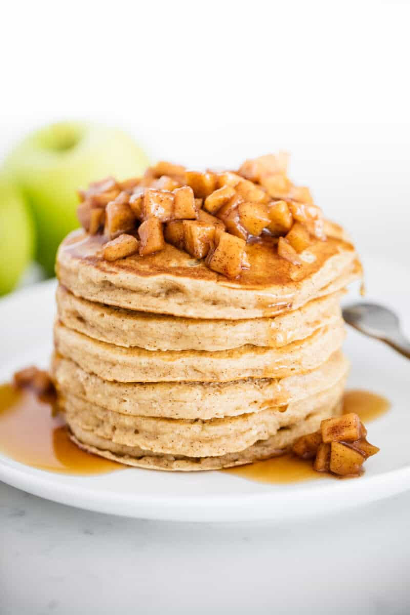 stack of apple pancakes on white plate