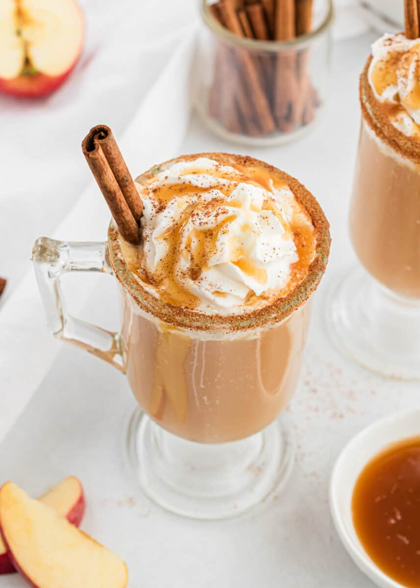 glass cup with caramel apple cider and cinnamon