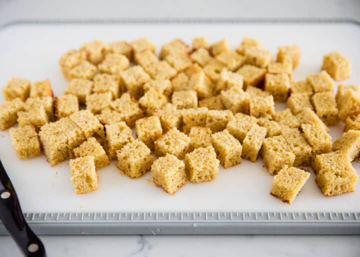 cornbread cubes on cutting board