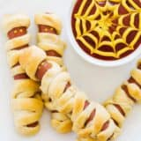 mummy hot dogs on white plate