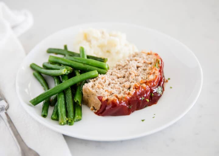 turkey meatloaf with green beans on plate