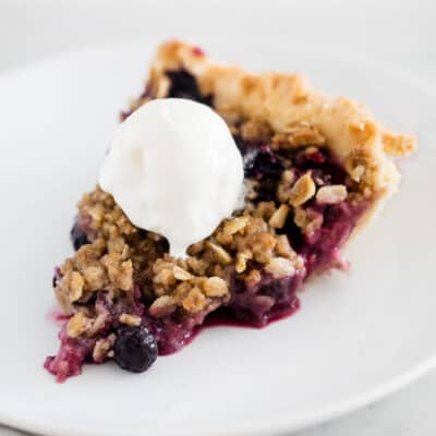 sliced berry pie on white plate