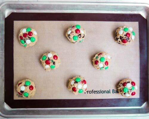 M&M Christmas cookie dough balls on pan