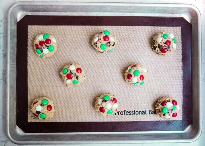 M&M Christmas cookie dough balls on pan