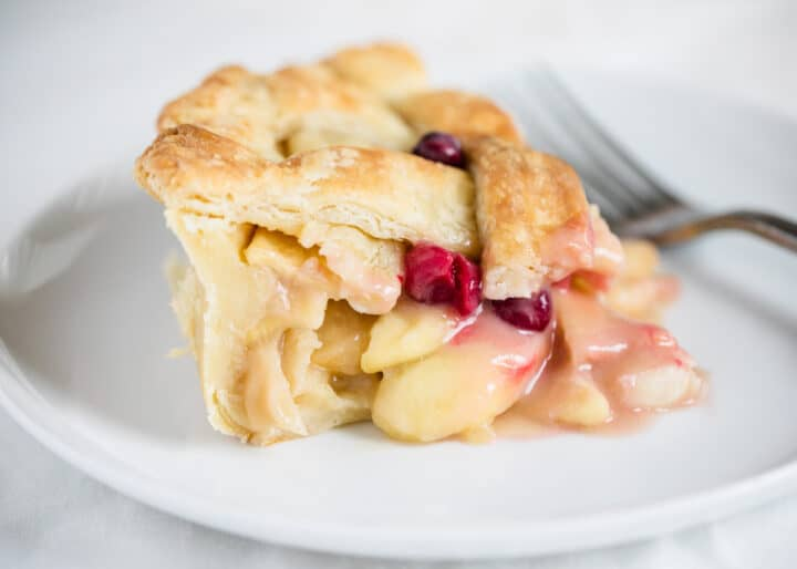 apple cranberry pie on white plate
