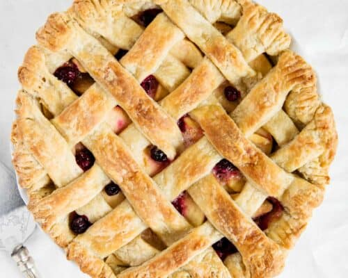 apple cranberry pie on white table