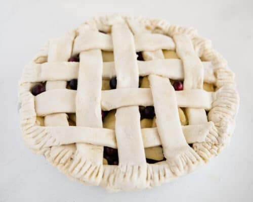 apple cranberry pie on table