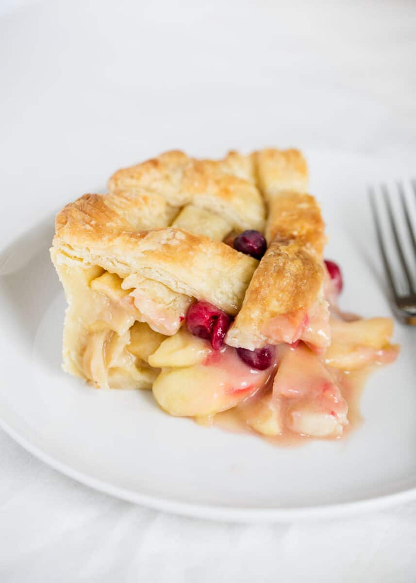 apple cranberry pie on plate