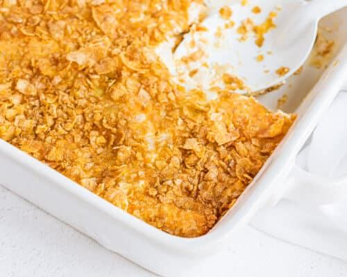 white pan with cheesy potatoes