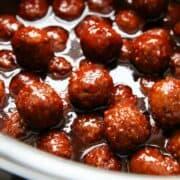 cranberry meatballs cooking in crockpot