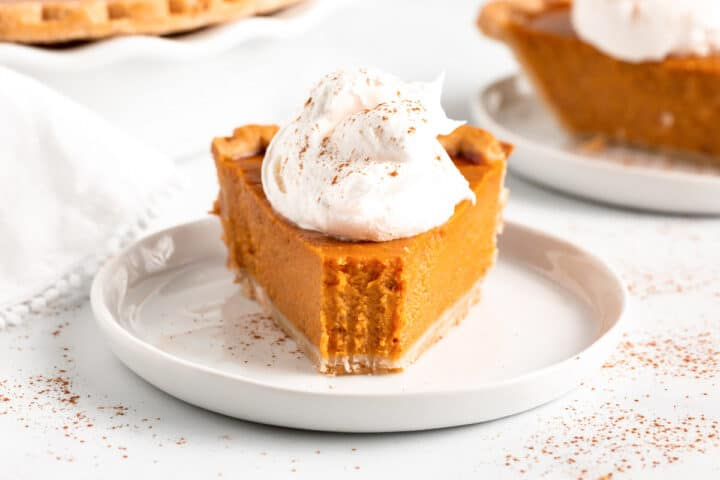 pumpkin pie slice on white plate