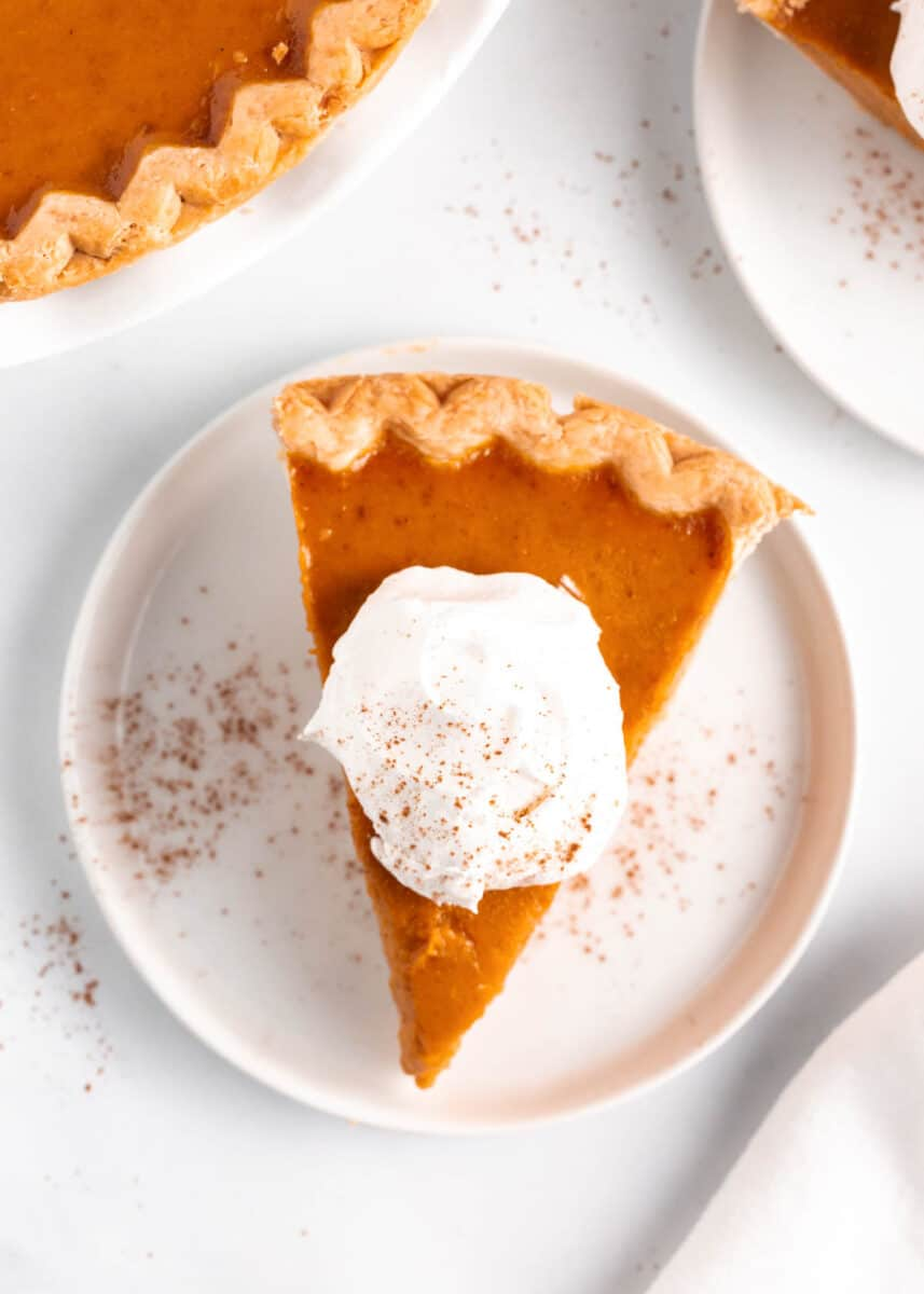 pumpkin pie slice with whipped cream