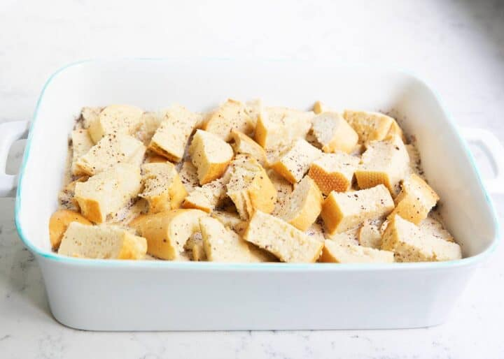 cubed bread in baking dish