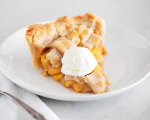 sliced peach pie on plate