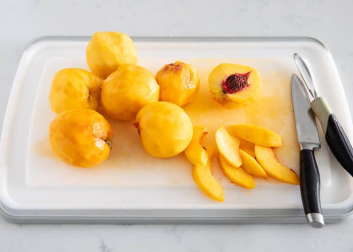 slicing peaches on cutting board